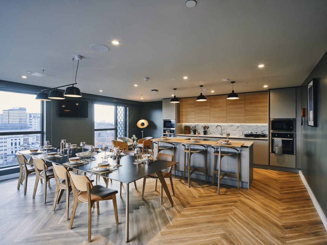 Symons House, Leeds - The private dining space includes built-in kitchen and island by Gemini. Photography by Gu Shi Yin