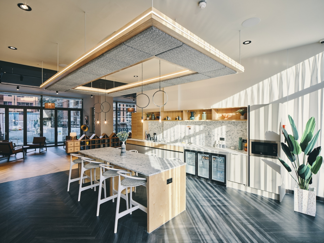 Symons House, Leeds - The communal kitchen, opposite the library area. Photography by Gu Shi Yin