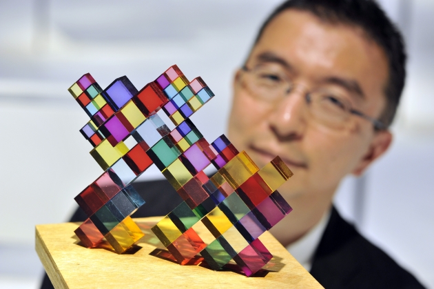 Sou Fujimoto, acclaimed Japanese architect, inspects Stacked Colours, one of 100 exhibits on display in his exhibition Futures of the Future at Japan House London