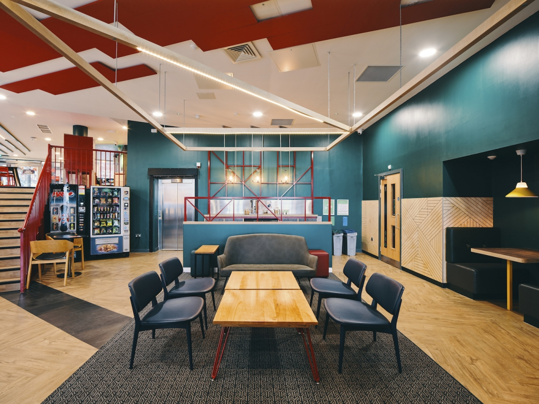 Huge-scale overhead ceiling rafts are in plywood with integrated lighting.