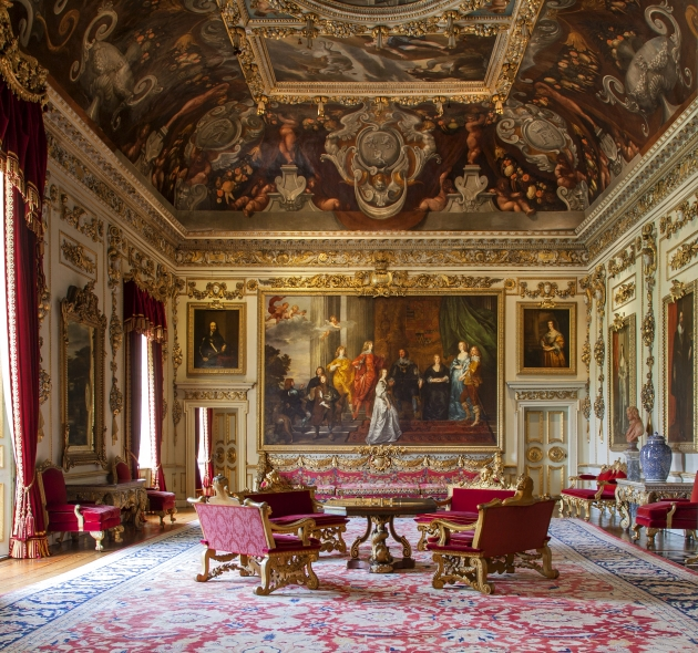 Wilton House. The Double Cube Room; one of the greatest of the great rooms of parade in England. The amount of gilding, the very large Van Dyck portrait of the Pembroke family and the red velvet upholstery are powerful enough to balance the weight of the strong colours of the painted, deep cove and ceiling. Courtesy © Derry Moore | Prestel