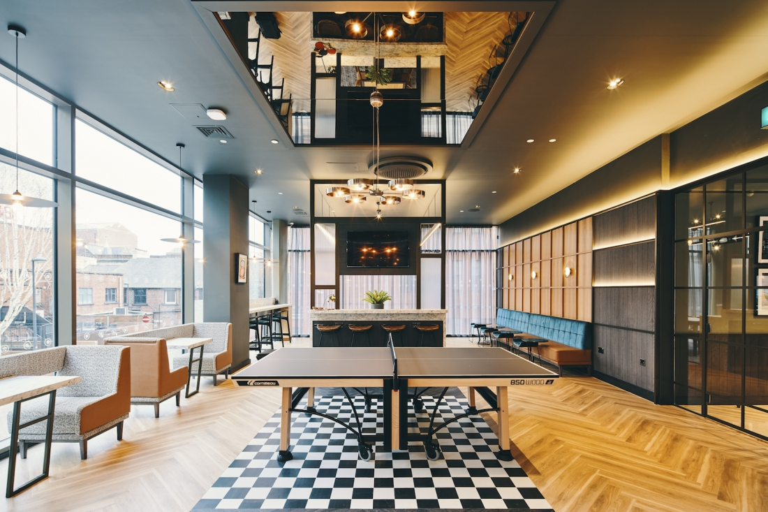 Symons House, Leeds - The central screen reaches from the dry bar to the ceiling. Photography by Gu Shi Yin