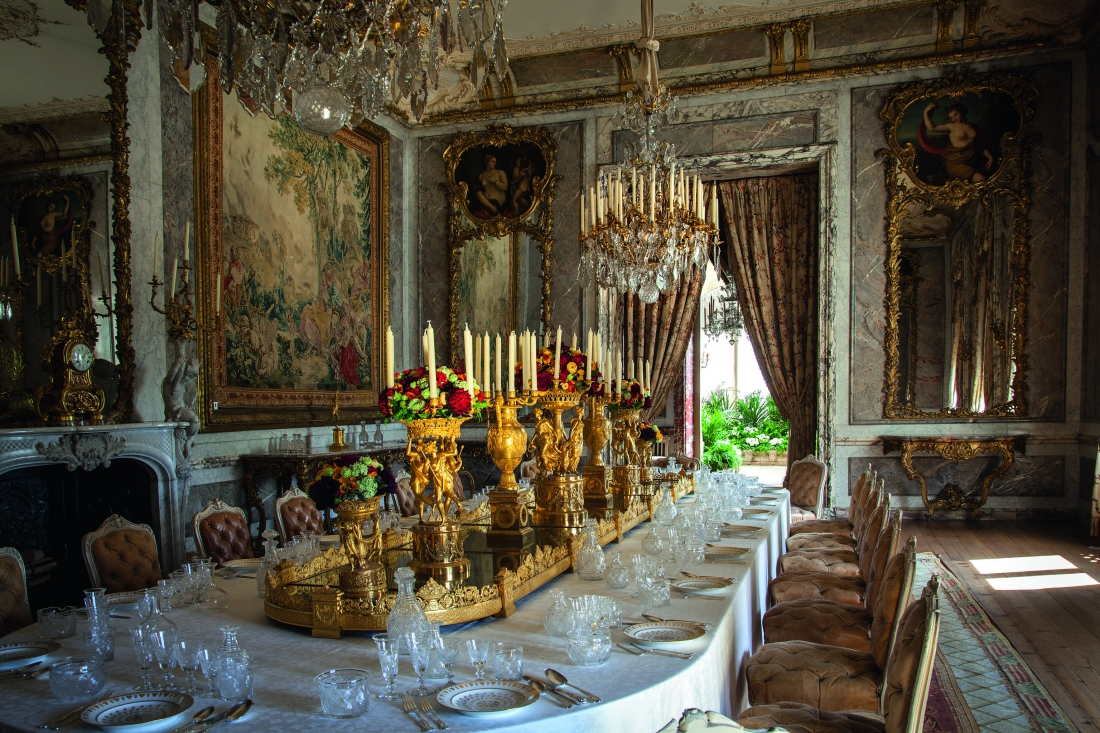 Waddesdon Manor. The Dining Room. Again looking towards the Conservatory with the table laid as for a formal banquet. The room was inspired by Louis XIV's state apartments at Versailles. The food was as complicated as the decorations. Courtesy © Derry Moore | Prestel